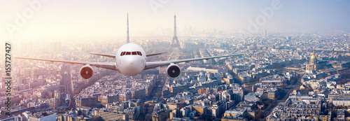 Fotografie, Obraz  Airplane frying over the center of Paris, France