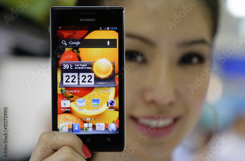 A model poses with a Huawei Ascend P1 smartphone at the