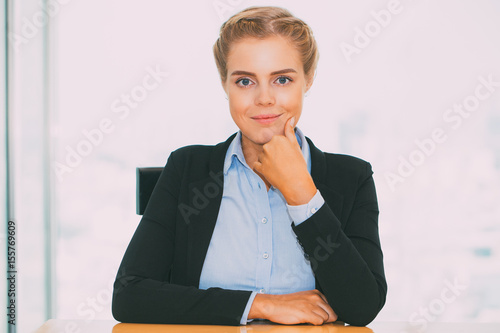 Plakát  Content Pretty Fair-haired Woman Sitting at Table