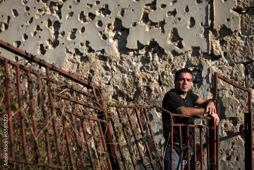 Laketa Poses For Picture In Front Of Building Destroyed During 1992 1995 War Bosnia Mostar