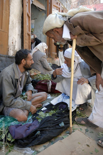 A man sells qat, a mild stimulant, as he sits in his shop at