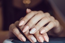 Nail Care. Closeup Of Beautiful Woman Hands Showing Perfect Nails . Beauty Care. High Resolution