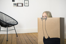 Girl Inside A Cardboard Box Pa...