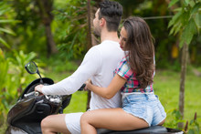 Couple Riding Motorcycle, Youn...
