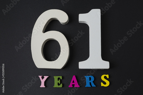 Poster  Letters and numbers-sixty-one on a black background.