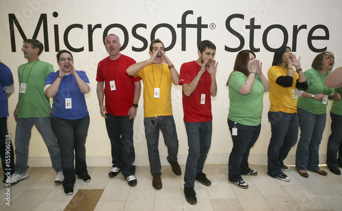 Employees Of The New Microsoft Store Cheer To A Waiting Crowd Before