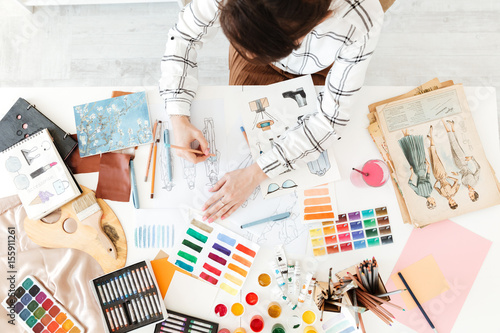 Top view cropped photo of young woman fashion illustrator drawing Tableau sur Toile