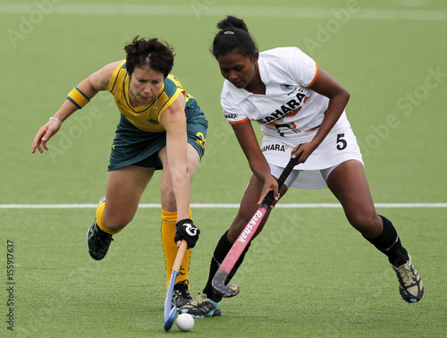 Attard of Australia and Lakra of India battle for the ball