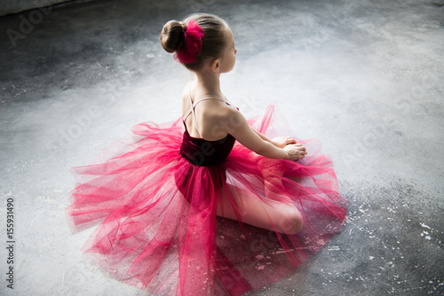 little ballerina sitting on floor