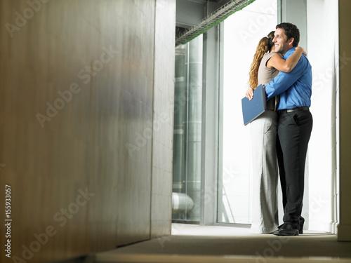 hugging a man