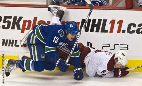Phoenix Coyotes Upshall Is Knocked Down By Canucks Torres During