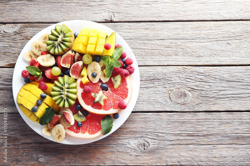 Fresh fruit salad on a grey wooden table