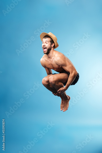 Photo  Jumping man isolated over blue