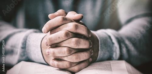 Close up of man with bible praying