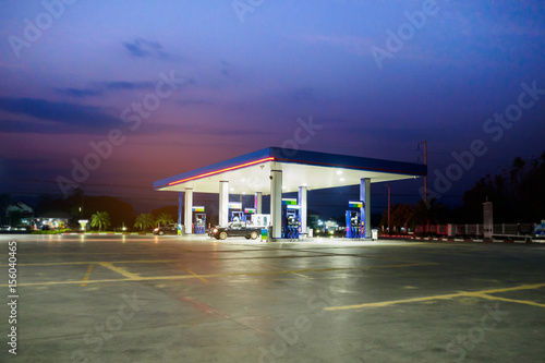 Fotografie, Obraz  gas station with clouds and sky at sunset