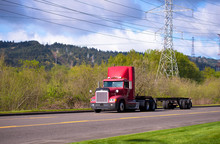 Red Big Rig On The Road With Power Line