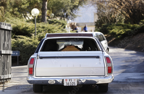 A hearse carrying a coffin arrives at the mortuary of Sion