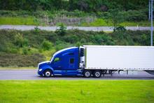 Modern Dark Blue Semi Truck Reefer Trailer Profile On Green Road
