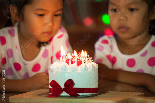 Outstanding Happy Twin Two Asian Little Girls Celebrating Birthday And Blowing Funny Birthday Cards Online Inifofree Goldxyz