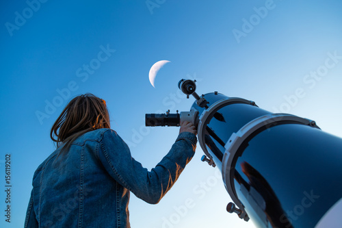 Girl looking at the Moon through a telescope. My astronomy work. Canvas Print