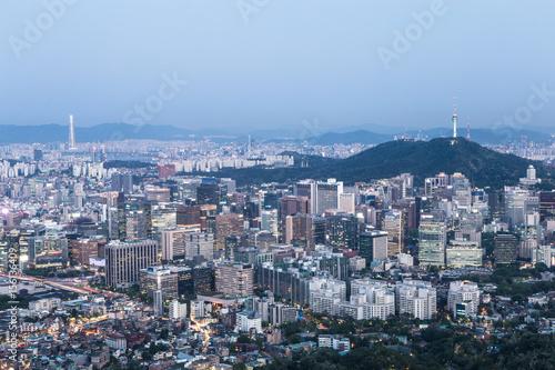 Stampa su Tela  Night falls above the Seoul, South Korea capital city