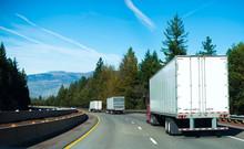 Convoy Semi Trucks Dry Van Trailers On Winding Highway Interstate I-5 Back View