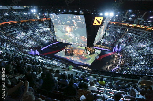 Fans watch a competition during The International Dota 2