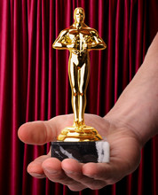 Awards Trophy On Red Background