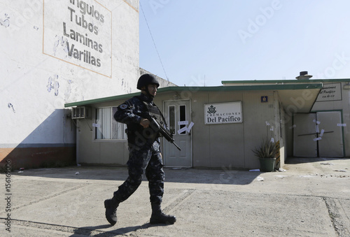 A police officer walks outside the sealed-off building