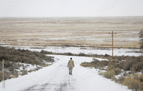 An occupier walks along a road at the Malheur National