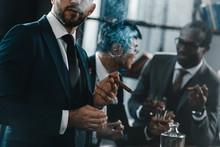 Businessman Smoking Cigar With...