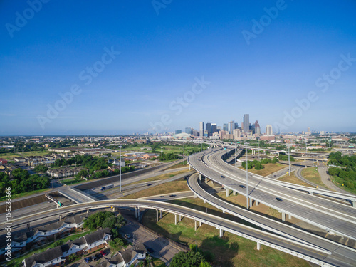 Poster Cracovie Aerial view Houston downtown and interstate 69 highway with massive intersection, stack interchange and elevated road junction overpass at early morning from the northeast side of Houston, Texas, USA