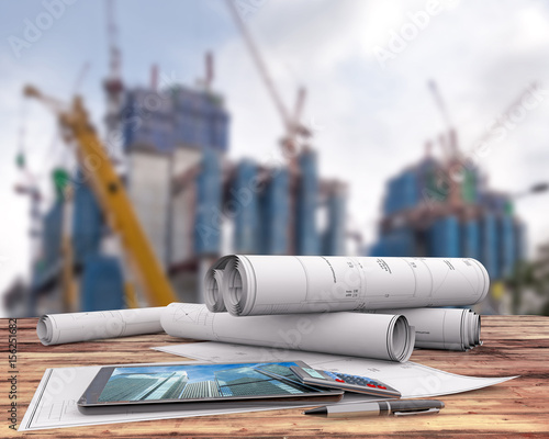 Blueprints and tablet on office table in the construction site buy blueprints and tablet on office table in the construction site malvernweather Images
