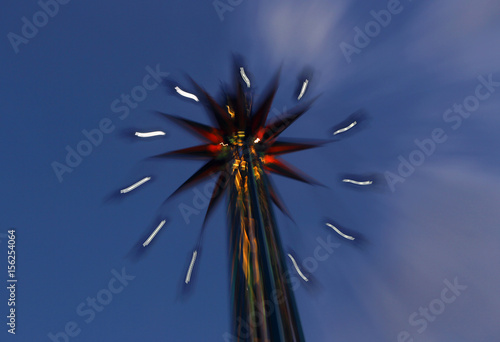 Visitors enjoy an amusement ride in an Athens luna park - Buy this