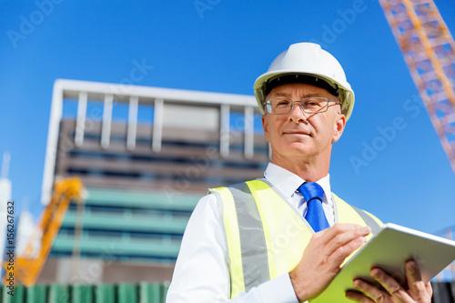 Engineer builder at construction site Wallpaper Mural