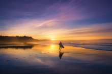 Surfer In The Beach At Sunset
