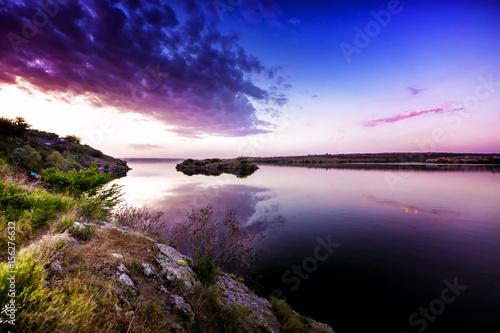 Foto op Aluminium Aubergine Beautiful sunset landscape on river. Clouds at sunset