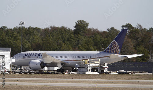 A United Airlines 787 Dreamliner jet is parked at the cargo