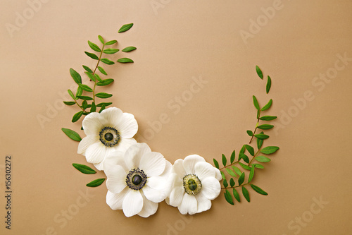 Anemone flowers wreath with green branches Canvas Print