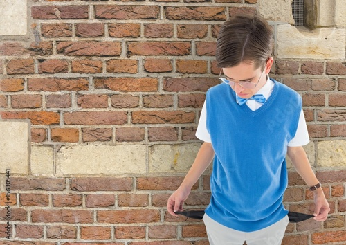 Fotografie, Tablou  Sad young man with empty pocket and brick background