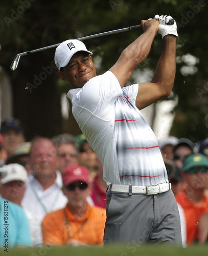 Tiger Woods of the U.S. hits off the fourth tee during first round ...