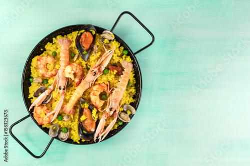 Spanish seafood paella in paellera white copyspace