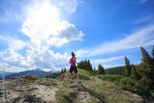 Fototapeta healthy woman running on beautiful mountain peak obraz na płótnie