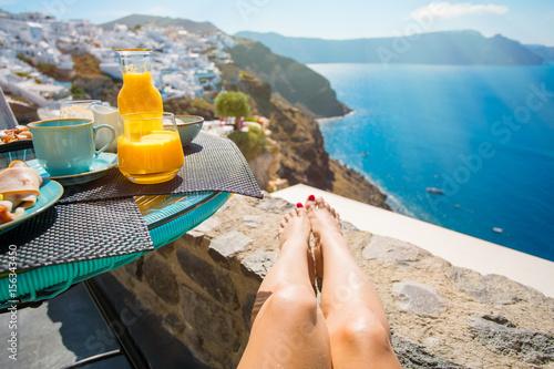 Fototapeta Woman enjoying breakfast in beautiful Santorini obraz