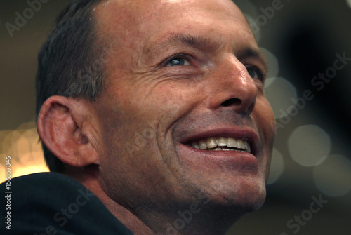 Opposition leader Abbott smiles at a luncheon in Melbourne