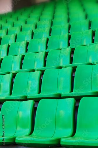 Spoed Foto op Canvas Stadion Green plastic seats at stadium