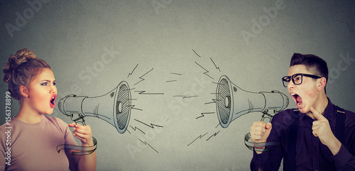 Quarrel between woman and man screaming at each other in megaphone Canvas Print