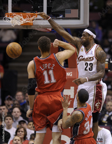 sports shoes f1e61 2ed6f Cleveland Cavaliers forward LeBron James stuffs the ball ...
