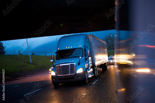 Aluminium Prints Night highway Bright semi truck in raining night lights on highway