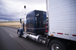 canvas print picture - Custom big rig dark blue semi truck with reefer trailer